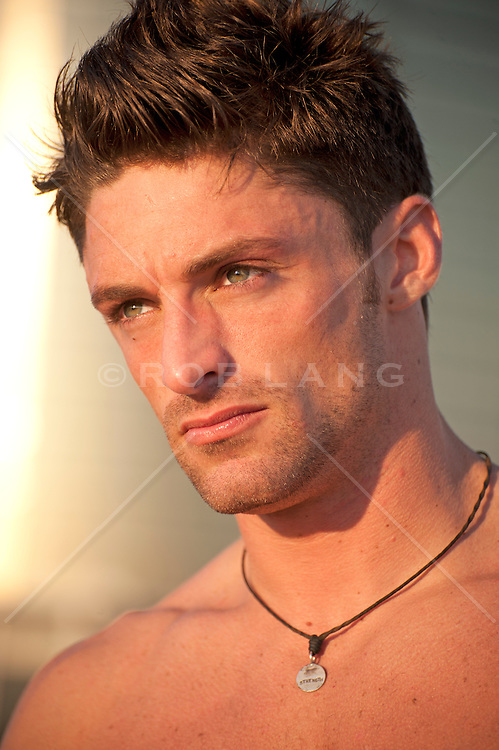 Portrait of shirtless man wearing a necklace