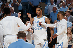 CHAPEL HILL, NC - FEBRUARY 05: Garrison Brooks #15 of the North Carolina Tar Heels during introductions before a game against the North Carolina State Wolfpack on February 05, 2019 at the Dean Smith Center in Chapel Hill, North Carolina. North Carolina won 113-96. North Carolina wore retro uniforms to honor the 50th anniversary of the 1967-69 team. (Photo by Peyton Williams/UNC/Getty Images) *** Local Caption *** Garrison Brooks