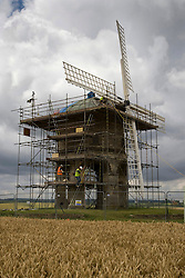 © Licensed to London News Pictures. 25/07/2011. Leamington Spa, Warwickshire. Chesterton Windmill, just off the Fosse Way, a Scheduled Ancient Monument is undergoing preservation work under the Guidance of English Heritage. The work, which will take two months will replace some stone blocks, renovate the sail frames and repaint the whips, stocks and also replace the zinc cladding on the dome-shaped roof, known as the cap at an estimated cost of £50,000. Photo credit : Dave Warren/LNP
