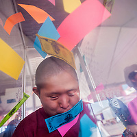 090513       Cable Hoover<br /> <br /> Lawrence Lopez grabs for paper money in a wind booth during youth day at the Navajo Nation Fair in Window Rock Thursday. The money could be traded for prizes at the fair's media tent.