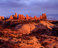 I waited for the sun to break thru a storm which made for great lighting so I could photograph Arches at sunset in Arches National Park Utah