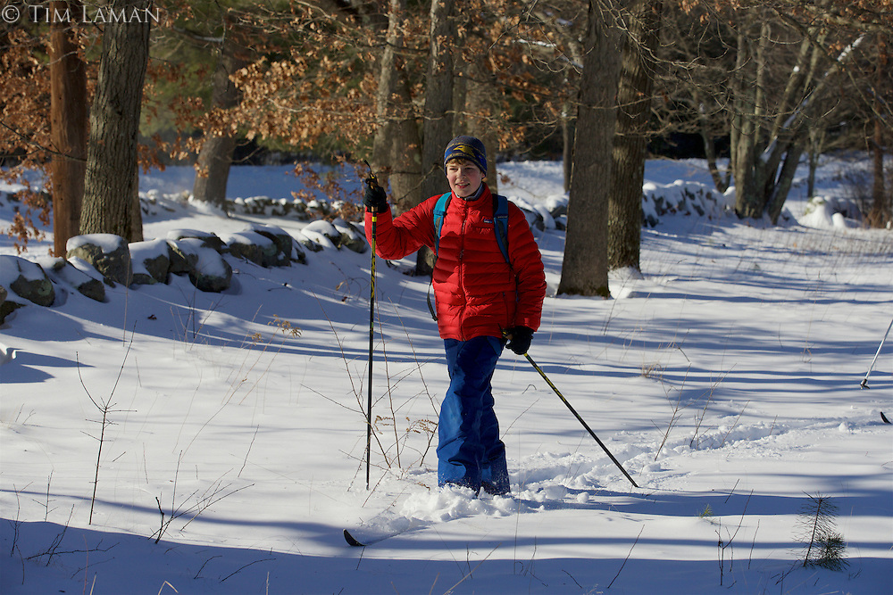 Russell Laman cross country skiing in the New England woods.
