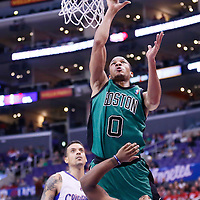 08 January 2014: Boston Celtics point guard Avery Bradley (0) goes for the layup over Los Angeles Clippers Maalik Wayns during the Los Angeles Clippers 111-105 victory over the Boston Celtics at the Staples Center, Los Angeles, California, USA.
