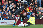 Liverpool forward Divock Origi (27)  and Burnley defender Matthew Lowton (2) tangle during the Premier League match between Burnley and Liverpool at Turf Moor, Burnley, England on 31 August 2019.