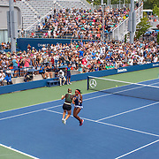 2019 US Open Tennis Tournament- Day Five.  Coco Gauff and Catherine McNally of the United States celebrate victory in Bryan brothers style after their win against Julia Goerges of German and Katerina Siniakova of the Czech Republic in the Women's Doubles Round One match on a packed Court Five at the 2019 US Open Tennis Tournament at the USTA Billie Jean King National Tennis Center on August 30th, 2019 in Flushing, Queens, New York City.  (Photo by Tim Clayton/Corbis via Getty Images)