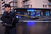 Four hostages were killed and four wounded in the kosher supermarket in Paris, where Amedy Coulibaly held civilians captive, 4 days after he was killed by the french police, antisemitism, people gather to pay tribute to the victims, police protects and works in the aera