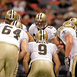2009 October 04: New Orleans Saints quarterback Drew Brees (9) huddles with teammates during a 24-10 win by the New Orleans Saints over the New York Jets at the Louisiana Superdome in New Orleans, Louisiana.