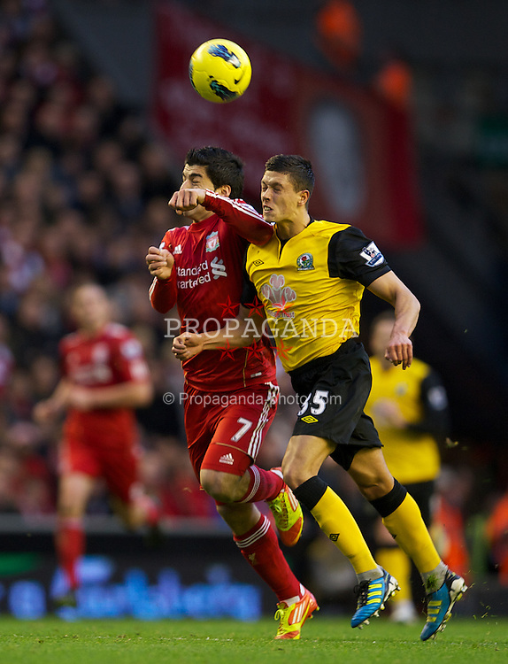 LIVERPOOL, ENGLAND - Boxing Day Monday, December 26, 2011: Liverpool's Luis Alberto Suarez Diaz in action against Blackburn Rovers' Jason Lowe during the Premiership match at Anfield. (Pic by David Rawcliffe/Propaganda)