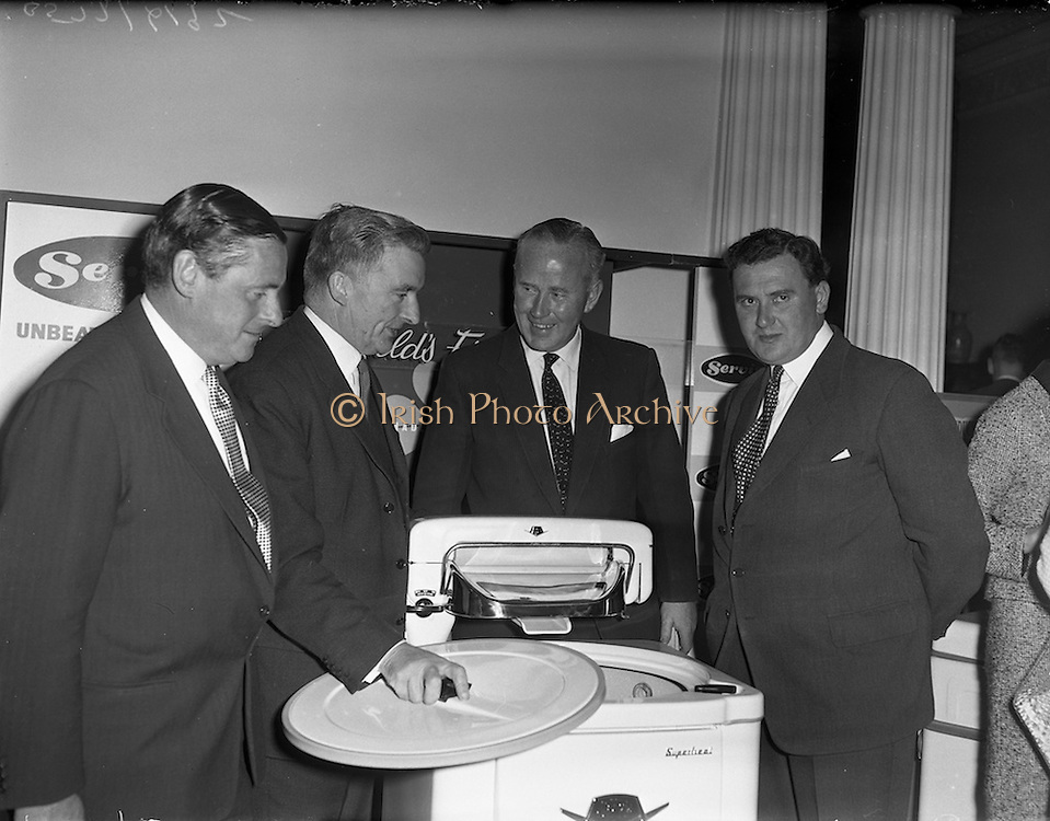 29/09/1960<br /> 09/29/1960<br /> 29 September 1960<br /> Servis Washing Machines Reception. Reception by Servis Washing Machines and G.E.C. held at the Shelbourne Hotel, Dublin to introduce new range of machines. Picture shows (l-r): Edward Wilkins, Managing Director, Messrs Wilkins and Mitchel Ltd., Darlaston, Staffordshire; Michael Hilliard Minister for Posts and Telegraphs; Martin F. McCourt, Managing Director G.E.C. Dunleer and G.L. Hay, Director Cork Iron and Hardware, Co. Cork, examining one of the new machines.