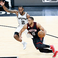 01 May 2017: Houston Rockets guard Eric Gordon (10) drives past San Antonio Spurs forward Kawhi Leonard (2) during the Houston Rockets 126-99 victory over the San Antonio Spurs, in game 1 of the Western Conference Semi Finals, at the AT&T Center, San Antonio, Texas, USA.