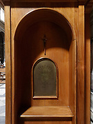 close up of confessors side of a confessional italy