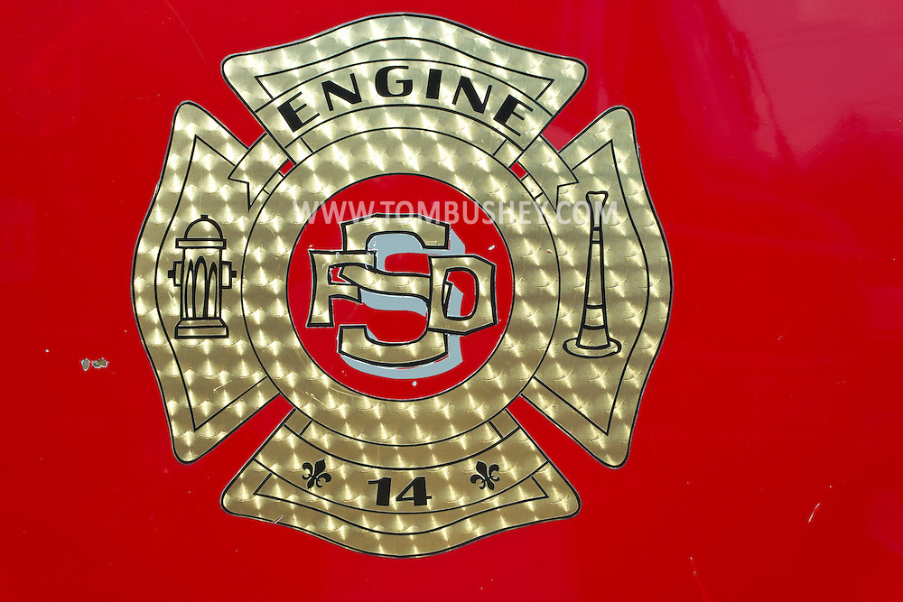 Circleville, New York - A closeup view of the insignia on an antique fire truck on display at the Catskill Fire Cats 36th Annual Muster on Aug. 4, 2012.