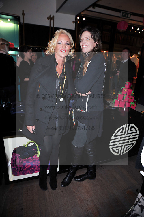 Left to right, AMANDA ELIASCH and MARTHA FIENNES at a private view of her work entitled 'Martha Fiennes' held at Shanghai Tang, Sloane Street, London on 9th February 2010.