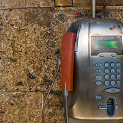 In the Cinque Terre region of western Italy, rustic, metal public payphones are available to visitors and locals but are not often used because of cell phone technology. Some can be found attached to cement walls. They have red receivers and a slot for a pre-paid phone or credit card.