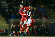 York City defender, on loan from Newcastle United, Kyle Cameron  and Exeter City forward, on loan from Bournemouth, Jayden Stockley  challenge for the ball  during the Sky Bet League 2 match between York City and Exeter City at Bootham Crescent, York, England on 16 February 2016. Photo by Simon Davies.