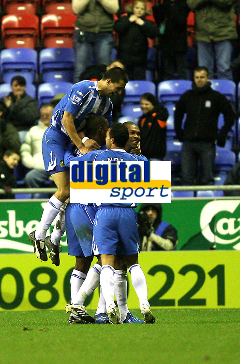 Photo: Paul Greenwood/Sportsbeat Images.<br />Wigan Athletic v Blackburn Rovers. The FA Barclays Premiership. 15/12/2007.<br />Wigan's Marcus Bent is mobbed by team mates as he scores his hat-trick