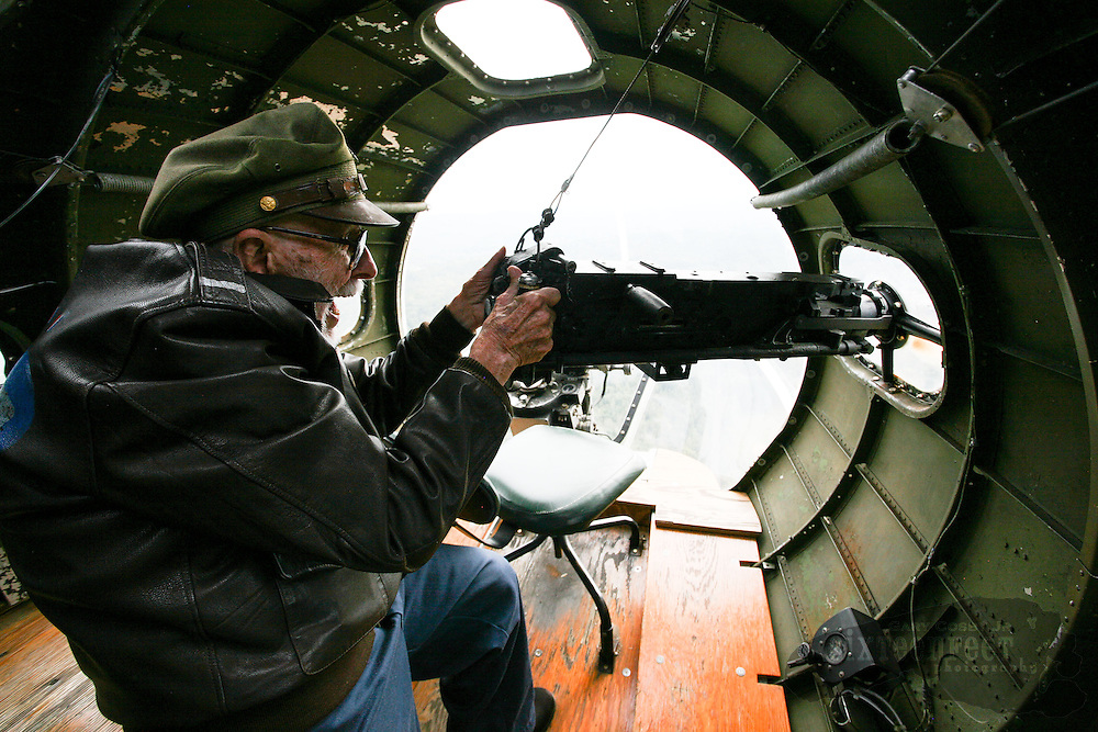 Gary Cosby Jr./Decatur Daily   World War II B17 navigator Bill Varnedoe relives some of his war service during a flight on the Memphis Belle Monday.  Varnedoe said he grabbed a gun just like this in combat to shoot at an approaching German aircraft and the gun jammed on him.  His normal job was navigator.  The aircraft will be open for tours and flights Saturday, October 25th at the Huntsville Executive Airport.