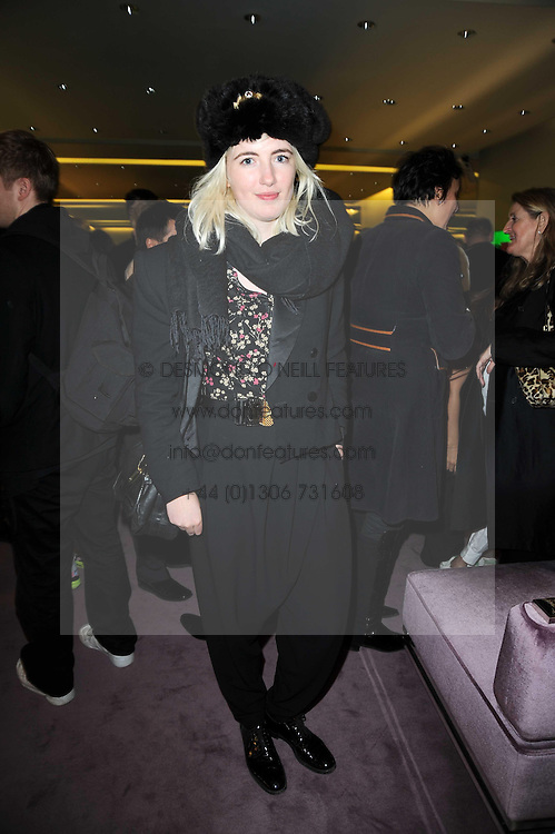 PHOEBE ARNOLD at a party hosted by Prada to celebrate launch of a book documenting the company's diverse projects in fashion, architecture, film and art held at their store 16/18 Old Bond Street, London on 19th November 2009.