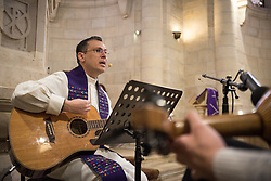 1 March 2020, Bethlehem: Rev. Munther Isaac plays guitar during Sunday service in the Evangelical Lutheran Christmas Church in Bethlehem.