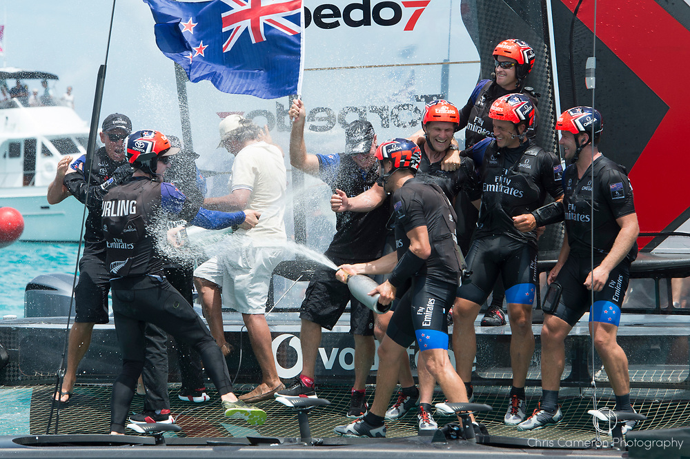 The Great Sound, Bermuda, 26th June 2017. Emirates Team New Zealand win race nine to win the America's Cup. Helmsman Peter Burling and trimmer Blair Tuke spray Moet Champagne in celebration.