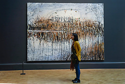 "© Licensed to London News Pictures. 08/06/2017. London, UK. A visitor stands in front of ""Und Du Bist Maler Geworden"" by Anselm Kiefer Hon RA.  Preview of the Summer Exhibition 2017 at the Royal Academy of Arts in Piccadilly.  Co-ordinated by Royal Academician Eileen Cooper, the 249th Summer Exhibition is the world's largest open submission exhibition with around 1,100 works on display by high profile and up and coming artists.<br />  Photo credit : Stephen Chung/LNP"