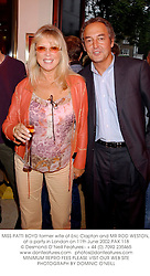 MISS PATTI BOYD former wife of Eric Clapton and MR ROD WESTON, at a party in London on 11th June 2002.	PAX 118