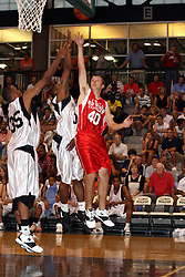 23 June 2007: Jeffrey Jordan, Loyola Academy grad, University of Illinois recruit and son of his Airness Michael Jordan, plays his last high school level basketball game. Jeffery joins Dernando Eiland in defending a shot by Matt Schick. The Illinois Basketball Coaches Association All-Star game is played in the Shirk Center on the campus of Illinois Wesleyan University in Bloomington Illinois.