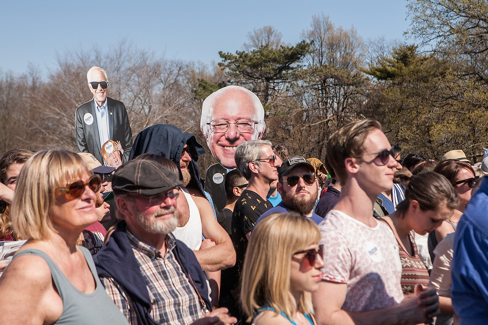 "Brooklyn, NY - 17 April 2016. Larger than life-sized images of Sander over the crowd.  Vermont Senator Bernie Sanders, who is running as a Democrat in the U.S. Presidential primary elections, held a campaign ""get out the  vote"" rally in Brooklyn's Prospect Park."