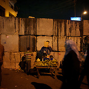 December 11, 2012 - Cairo, Egypt: A street vendor sells goods outside the presidential place in Cairo, where tens of thousands gathered to voice their anger at the planned constitution, which will be put to a referendum next Saturday...The Egyptian army has reportedly called talks between President Mohamed Morsi and the opposition to end violent protests against a draft constitution...Sporadic clashes between supporters and opponents of president Mohamed Morsi, erupted in the past week over his assumption of extraordinary powers and the scheduling of the referendum. (Paulo Nunes dos Santos/Polaris)