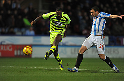 Yeovil Town's Ishmael Miller shoots at goal. - Photo mandatory by-line: Alex James/JMP - Tel: Mobile: 07966 386802 29/12/2013 - SPORT - FOOTBALL - John Smith's Stadium - Huddersfield - Huddersfield Town v Yeovil Town - Sky Bet Championship