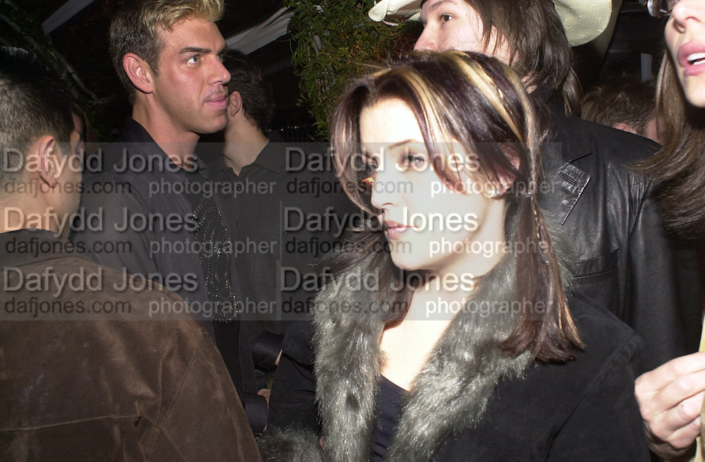 Lisa Marie Presley, and Kevyn Acoin. Talk pre-globe Awards Party. Mondrian, Los Angeles. 22/1/2000. <br />