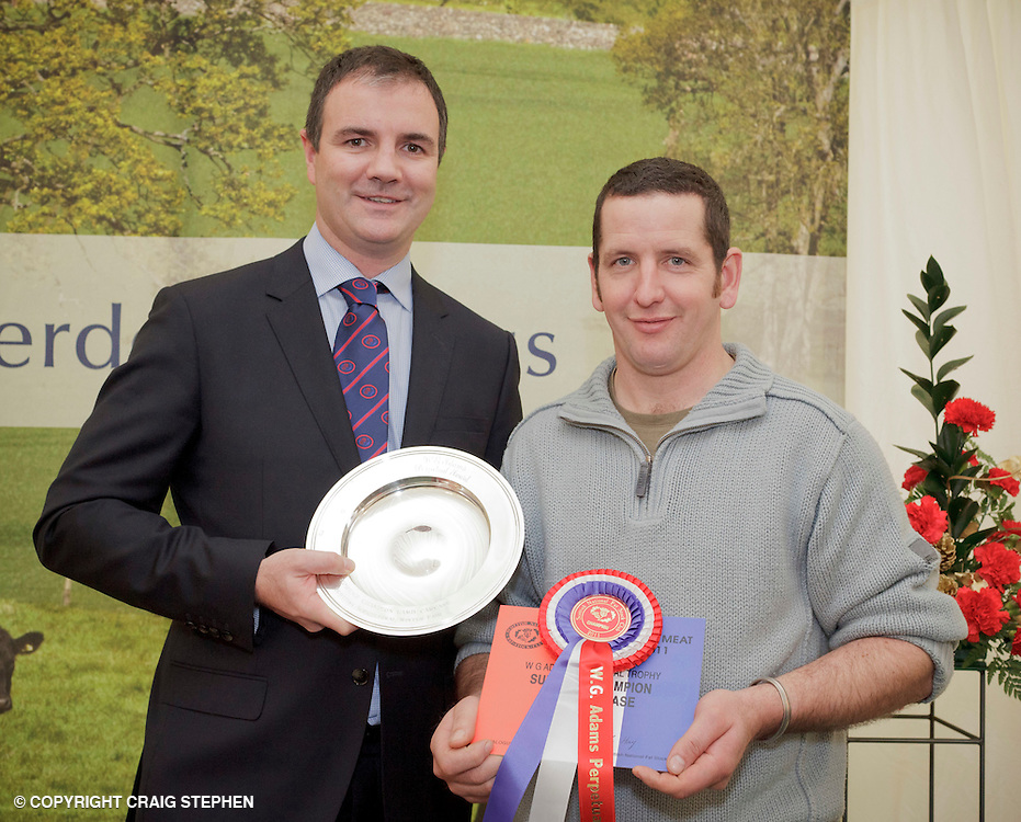 Scottish National Premier Meat Exhibition & competition to promote Scottish livestock from farm to consumer, sponsored by Marks & Spencer. Held at Scotbeef Ltd, Bridge of Allan, Saturday 19th Novermber, 2011...Malcolm Copland, head of trading at Marks & Spencer presents Andrew Baillie, Carstairs Mains, Lanark - champ lamb carcase