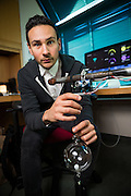 IBM Research designer Raphael  Arar poses for a portrait with a musical art installation in his office at the IBM Research facility in San Jose, California, on January 31, 2017. (Stan Olszewski for Silicon Valley Business Journal)