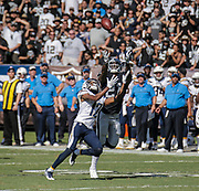 Oct 09 2016 - Oakland U.S. CA - Chargers quarterback Philip Rivers #17 attempt a deep pass to wide receiver Travis Benjamin #12 almost intercepted by Oakland Raiders cornerback Sean Smith #21during the NFL Football game between San Diego Chargers and the Oakland Raiders 34-31 win at O.co Coliseum Stadium Oakland Calif. Thurman James / CSM
