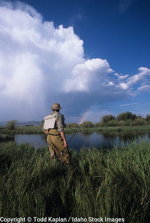 Idaho, Silver Creek Preserve, Spring Creek, Fly Fishing, fisherman, summer, storm clouds, man casting, late afternoon, Rainbow man looking, Ryan Manning