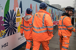London, UK. 22 January, 2020. Construction workers pass a site designated for the HS2 high-speed rail line close to Euston station. There has been considerable land purchase and clearance in the Euston area. Cost projections for the project are reported to have risen to £106bn and the Transport Secretary Grant Shapps has confirmed that the Government will make a decision regarding its viability in February 2020.