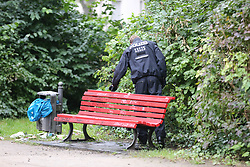 September 9, 2017 - Berlin, Berlin-Steglitz, Germany - In the Berlin district in Steglitz a corpse was found on Friday morning in a small park on Schloßstraße shopping street. According to police, it is a 47-year-old man. A murder commission took over the case. The photo shows Policemen looking for evidence in the bushes of the park in Berlin-Steglitz (Credit Image: © Simone Kuhlmey/Pacific Press via ZUMA Wire)