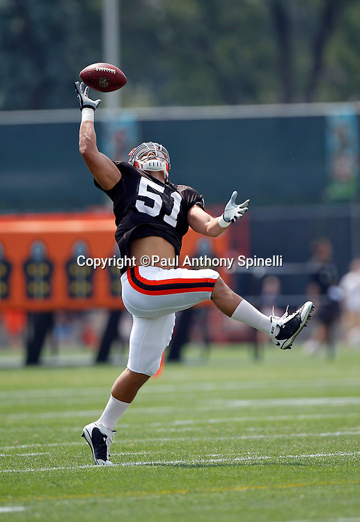 Cleveland Browns linebacker Chris Gocong (51) leaps to catch a pass during NFL football training camp at the Cleveland Browns Training Complex on Monday, August 9, 2010 in Berea, Ohio. (©Paul Anthony Spinelli)