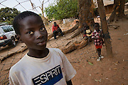 Bissau children and kids playing soccer, football