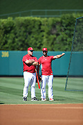 ANAHEIM, CA - JULY 26:  Mike Scioscia #14 of the Los Angeles Angels of Anaheim talks to an animated Albert Pujols #5 of the Los Angeles Angels of Anaheim during batting practice before the game against the Detroit Tigers at Angel Stadium on Saturday, July 26, 2014 in Anaheim, California. The Angels won the game in a 4-0 shutout. (Photo by Paul Spinelli/MLB Photos via Getty Images) *** Local Caption *** Mike Scioscia