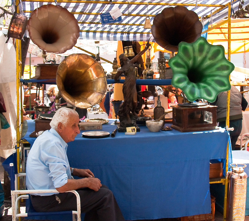 It seems the seller of these old phonographs matches the period. Sunday market. Buenos Aires, Argentina.