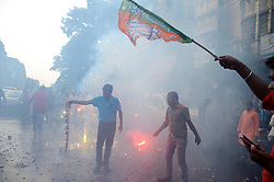 July 27, 2017 - Kolkata, West Bengal, India - Supporter set off fire cracker during the celebration in Kolkata. Bengal Bharatiya Janta Party leaders and supporter celebrating after the Nitish Kumar took over as the Chief Minister of Bihar with the help of Bharatiya Janta Party support on July 27, 2017 in Kolkata. (Credit Image: © Saikat Paul/Pacific Press via ZUMA Wire)