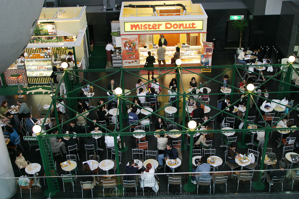 Beautifully appointed new Kyoto Railway Station with ubiquitous fast food accompaniment. Mister Donut. Kyoto, Japan.