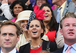 Camilla Henderson, the daughter of trainer Nicky Henderson watches the opening race on the second day of Glorious Goodwood<br /> London,  Wednesday, 31st July 2013<br /> Picture by Stephen Lock / i-Images