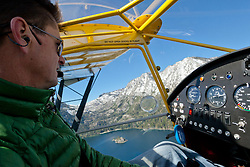 """""""Pilot over Emerald Bay 3"""" - This pilot was photographed flying an amphibious seaplane over Emerald Bay, in Lake Tahoe, CA."""