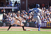 San Francisco Giants first baseman Brandon Belt (9) catches a throw at first base to get Los Angeles Dodgers left fielder Howie Kendrick (47) out at AT&T Park in San Francisco, Calif., on October 1, 2016. (Stan Olszewski/Special to S.F. Examiner)