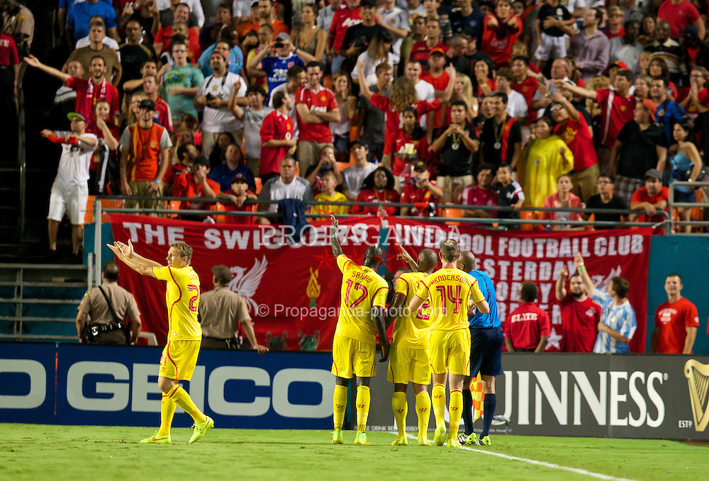 MIAMI, USA - Monday, August 4, 2014: Liverpool's players complain to the assistant referee after he awarded Manchester United a goal after the ball went out of play during the International Champions Cup Final match at the SunLife Stadium on day fifteen of the club's USA Tour. (Pic by David Rawcliffe/Propaganda)