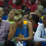 Chicago Sky Forward ELENA DELLE DONNE (11) holds her forehead  while sitting on the bench after leaving the game in the third quarter after colliding with Washington Mystics Center KIA VAUGHN (9) Wednesday, July. 24, 2013 at The Verizon center in Washington DC.
