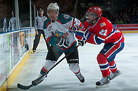 KELOWNA, CANADA -JANUARY 29: Jesse Lees #2 of the Kelowna Rockets is checked into the boards by Dominic Zwerger LW #22 of the Spokane Chiefs during the first period on January 29, 2014 at Prospera Place in Kelowna, British Columbia, Canada.   (Photo by Marissa Baecker/Getty Images)  *** Local Caption *** Jesse Lees; Dominic Zwerger;