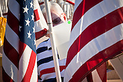 """10 SEPTEMBER 2011 - TEMPE, AZ:     Visitors to the """"Healing Field"""" in Tempe, AZ, look at note cards that memorialize people killed on the Sept 11, 2001, terrorists attacks. The """"Healing Field,"""" a display of 2,996 flags, one for each person killed in the September 11 terrorists attacks on the World Trade Center in New York City and Washington DC, have become an annual tradition in Tempe. The event is sponsored by the National Exchange Club.     PHOTO BY JACK KURTZ"""